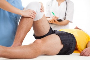 Doctor checking a knee recovering in hospital