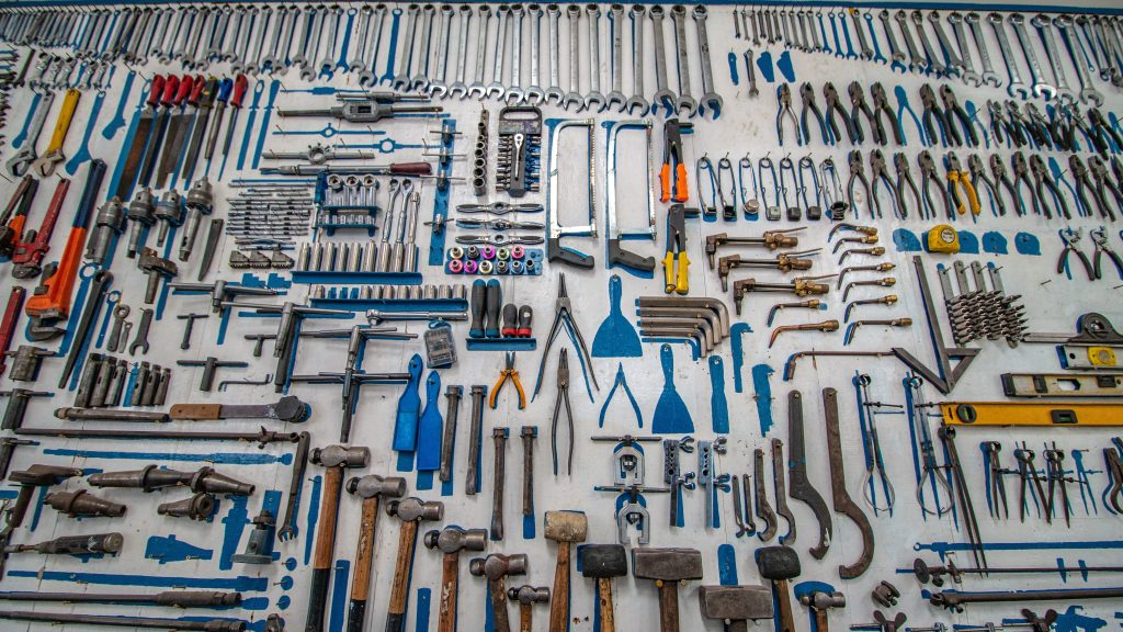 Image of tools all arranged by size and location, with painted tool-shaped spots where tools are missing.